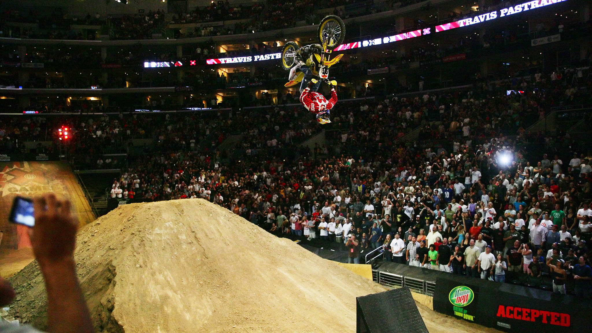 Travis Pastrana shocked the Staples Center crowd in 2006 as he completed the first-ever double backflip on a motorcycle to win Moto X Best Trick at X Games Los Angeles.
