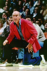 Jack Ramsay striking his familiar coaching pose on the sideline.
