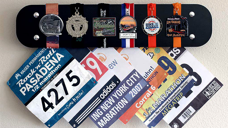 You work hard to earn those medals, so why have them tossed aside collecting dust? RunRilla's display racks allow you to show off those medals and race bibs in a stylish fashion, preserving them for years to come.