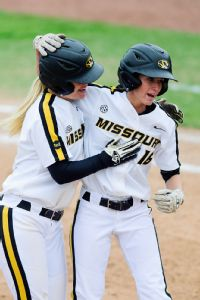 Missouri's Angela Randazzo, left, congratulates teammate Corrin Genovese after the Tigers pulled out a victory against Bradley.