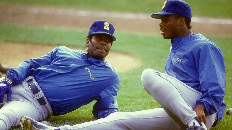 Ken Griffey Sr. and Ken Griffey Jr. became the first father-son duo in history to play on the same baseball team when they were members of the Seattle Mariners in 1990. Both Griffeys had stellar careers -- with the elder winning two World Series titles and earning three All-Star bids and the younger winning the AL MVP in 1997 and being named to the All-Star team 13 times. Griffey Jr.'s son, Trey, is a wide receiver for the Arizona Wildcats, and his daughter, Taryn, has signed to play basketball at Arizona next season.