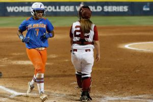 Florida's Kelsey Stewart scores for Florida in Game 1 of the NCAA Women's College World Series softball. The Gators won 5-0.