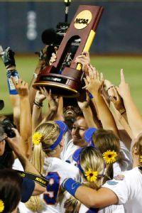 Florida pitcher Hannah Rogers (center) hoisted the national championship trophy and was named the WCWS most outstanding player.
