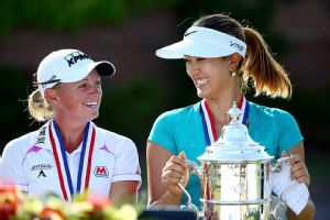 Michelle Wie had to hold off a hard charge by world No. 1 Stacy Lewis to capture the grandest prize of all.
