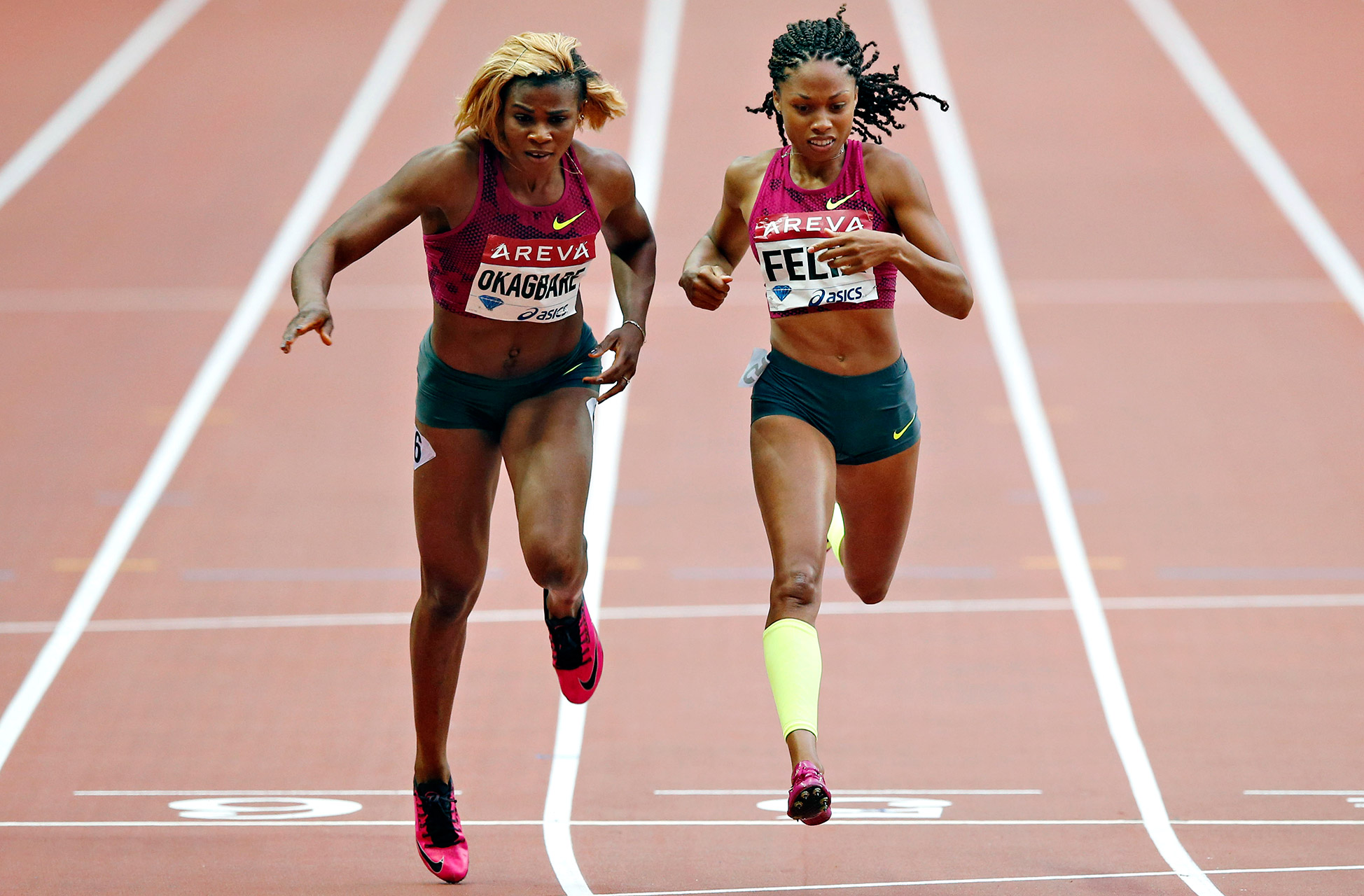 Nigeria's Blessing Okagbare, left, crosses the finish line to win the 200-meter race ahead of American Allyson Felix during the Diamond League meeting at Stade de France stadium, in Saint Denis, north of Paris.
