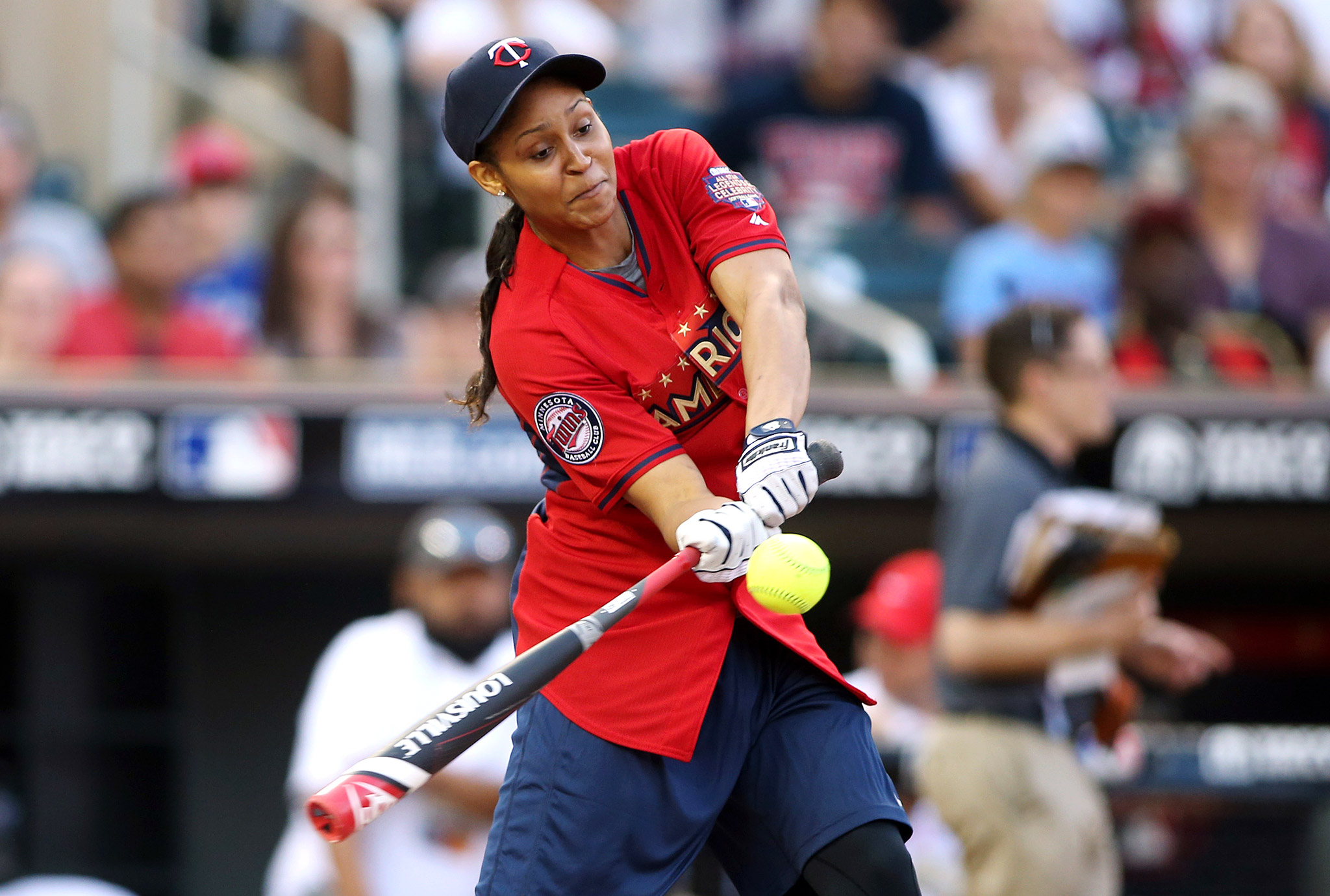 Minnesota Lynx All-Star Maya Moore at bat during the Taco Bell Legends & Celebrity softball game during Major League Baseball All-Star festivities at Target Field in Minneapolis.