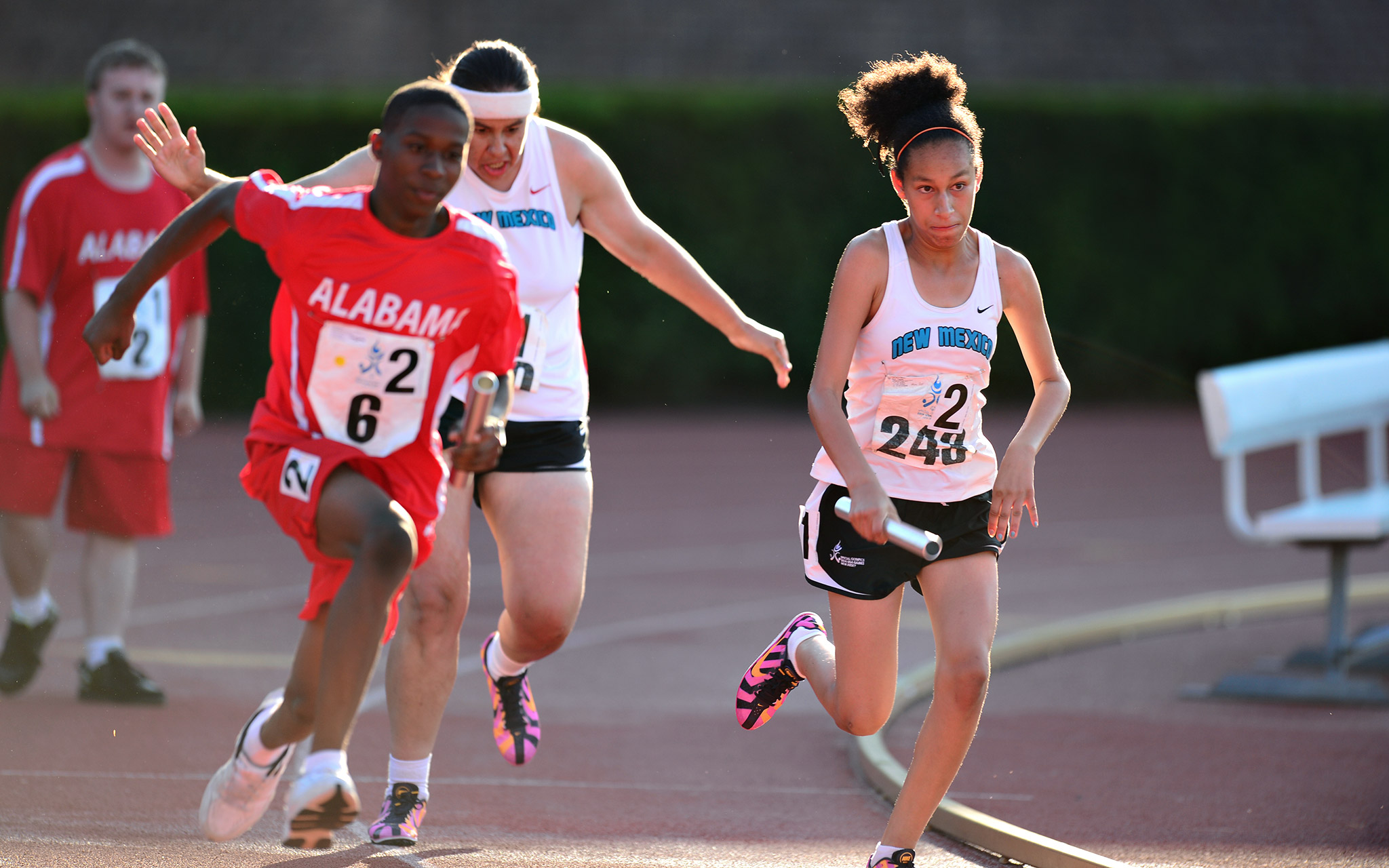 Devontay Henderson of Alabama and Ayanna Reid of New Mexico battle neck and neck in the 4x100M relay. Team Alabama won the gold.