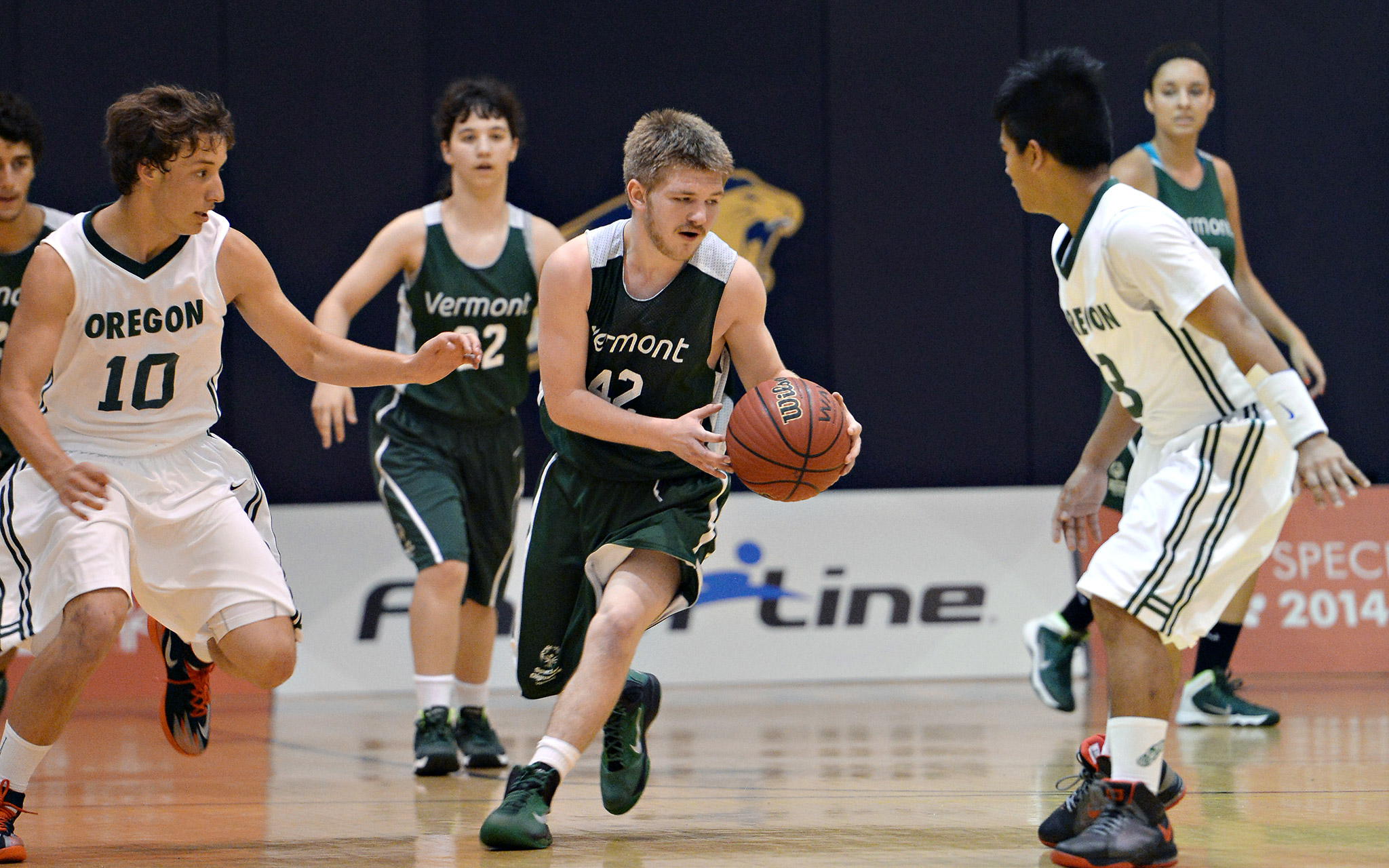 Patrick Burke-Willett of the Vermont Unified Sports five-a-side team leads his teammates down the court against Oregon. The Oregon team went on to claim silver in its division.