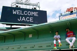 Jace Andrews and Dustin Pedroia hang out in the dugout.