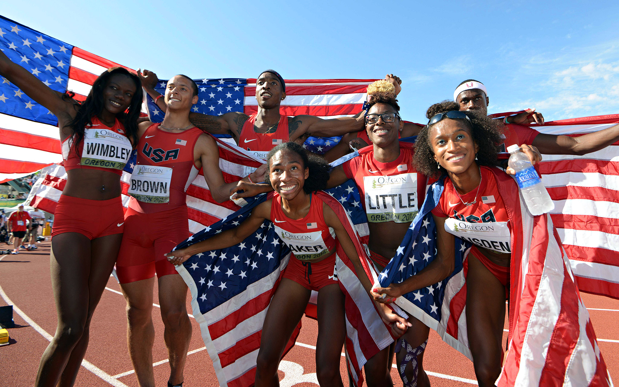 U.S. men's and women's 4 x 400-meter relays pose after winning gold in the IAAF junior world championships. From left: Shakima Wimbley, Tyler Brown, Michael Cherry, Olivia Baker, Shamier Little, Josephus Lyles, Kendall Baisden and Ricky Morgan.