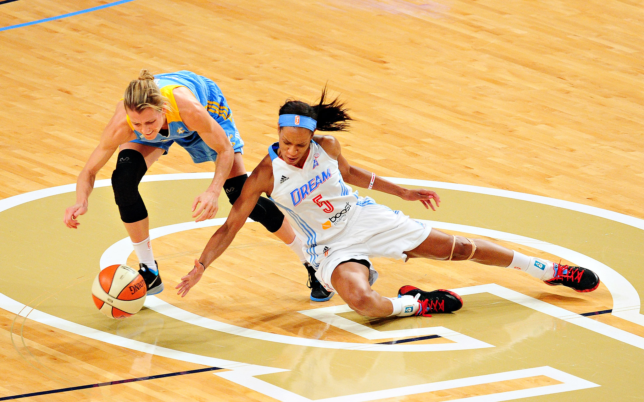 The Atlanta Dream's Jasmine Thomas battles for a loose ball against the Chicago Sky's Allie Quigley during their WNBA game at McCamish Pavilion in Atlanta.  The Sky held off the Eastern Conference-leading Dream 79-75.