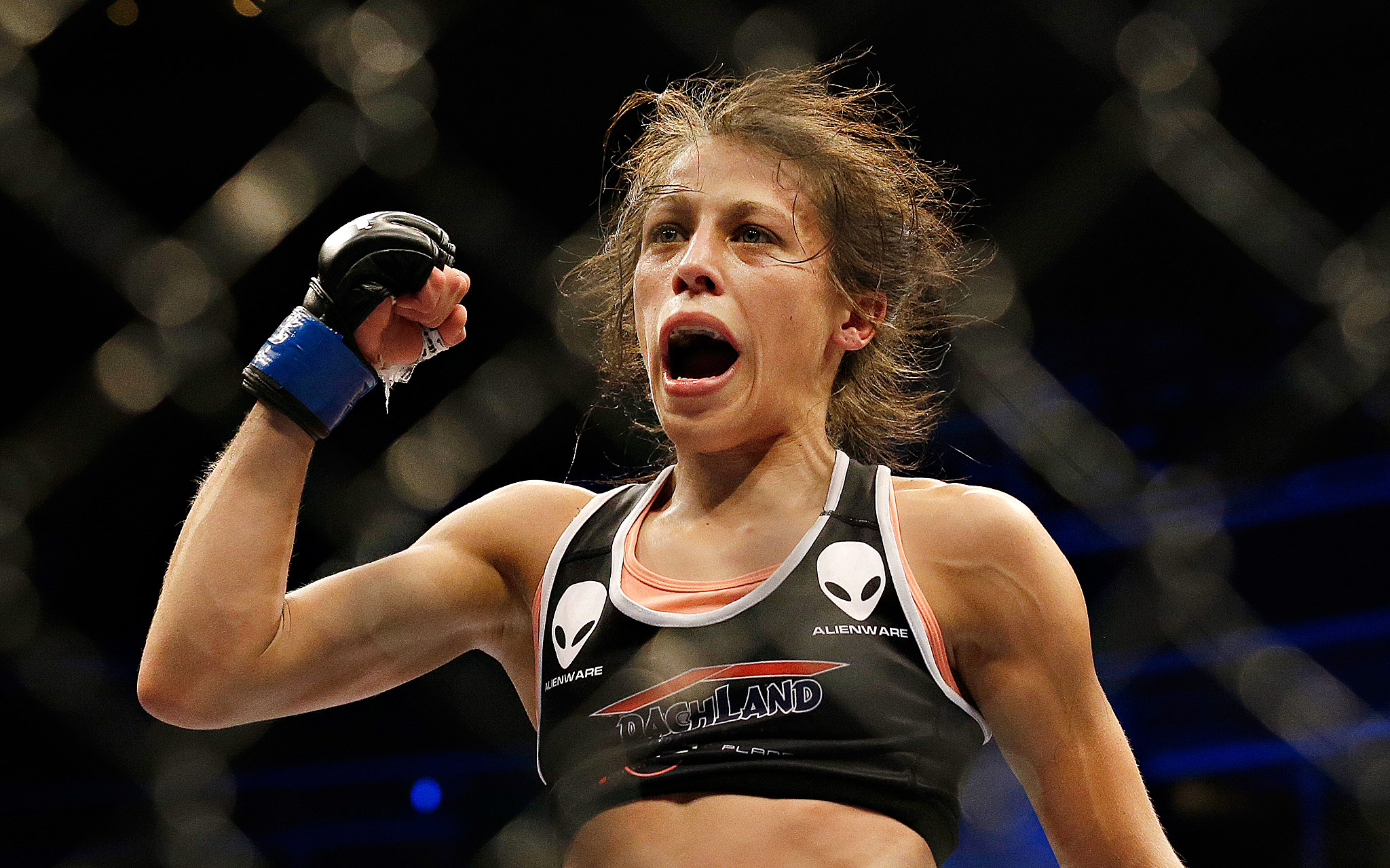 Joanna Jedrzejczyk celebrates after beating Juliana Lima by unanimous decision in a women's strawweight mixed martial arts bout at a UFC on Fox event in San Jose, California.