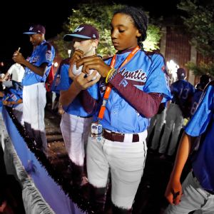 Mo'ne Davis signs autographs during a parade in Williamsport this week.