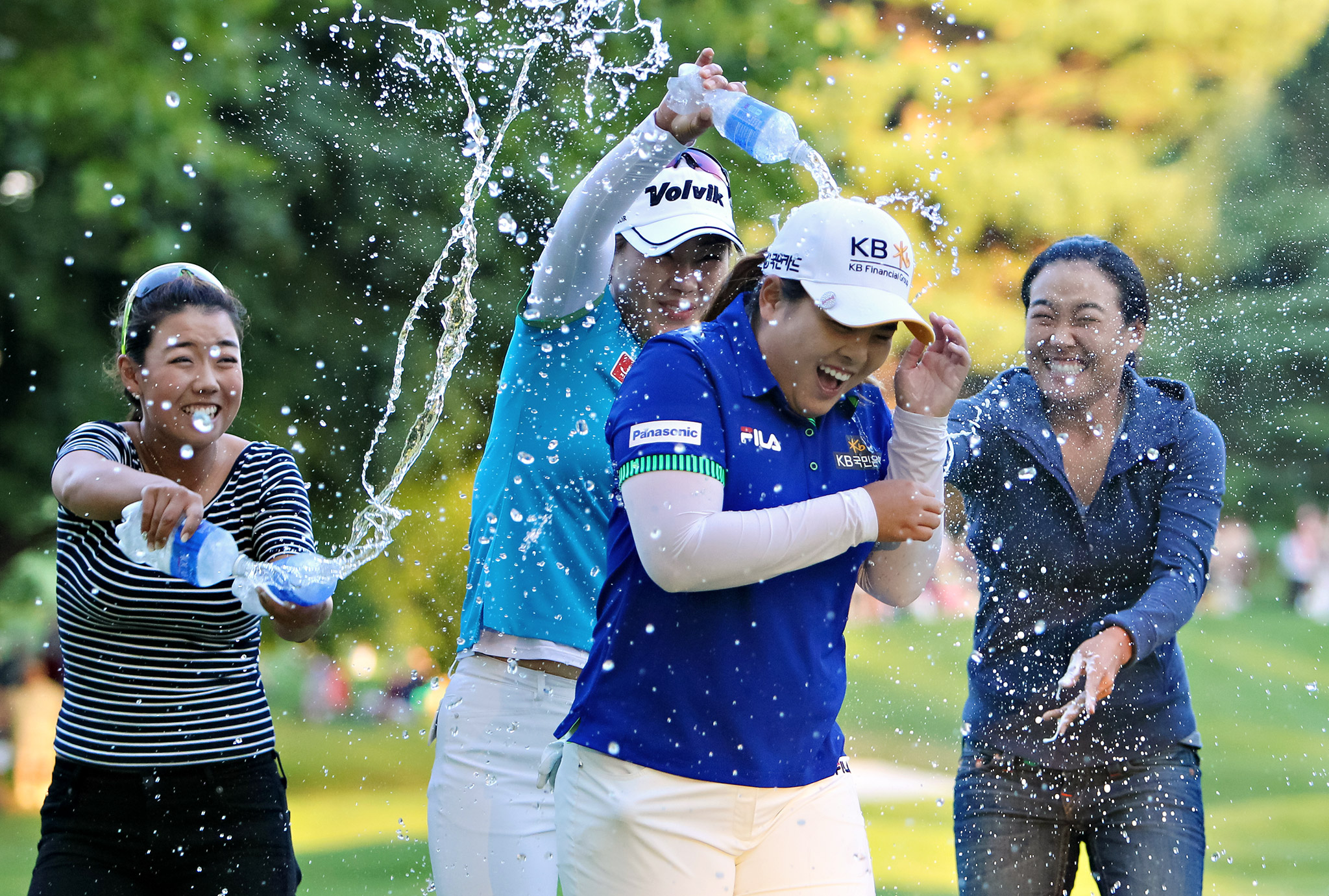 Inbee Park and gets sprayed with champagne after winning the LPGA Championship in Pittsford, N.Y. Park successfully defended her title, beating Brittany Lincicome with a par on the first hole of a playoff to end the United States' major streak at three.