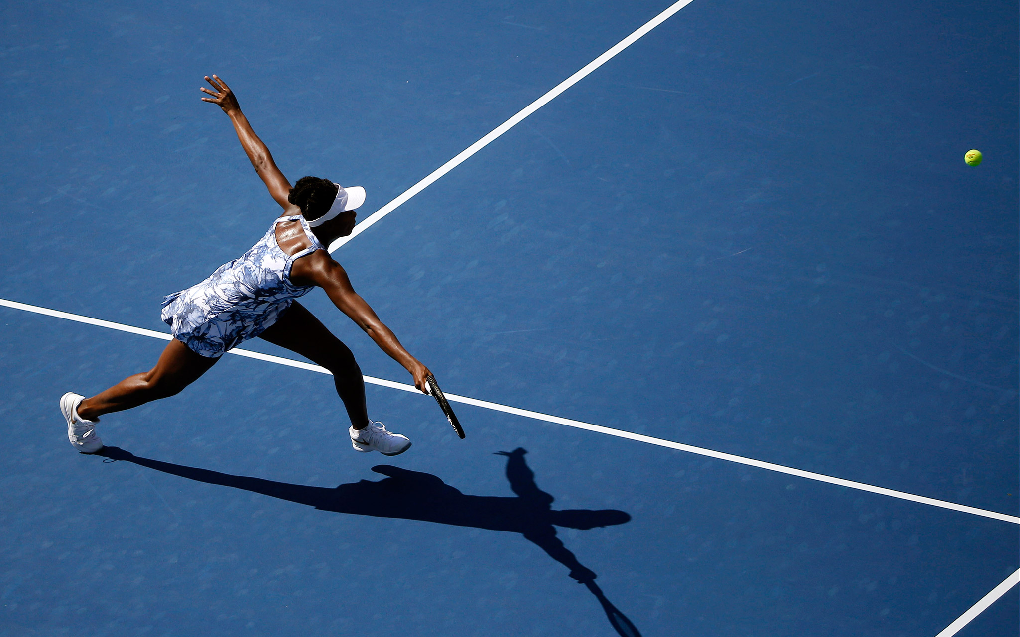 Venus Williams was stretched in her first-round match Monday but held on to beat Kimiko Date-Krumm 2-6, 6-3, 6-3.