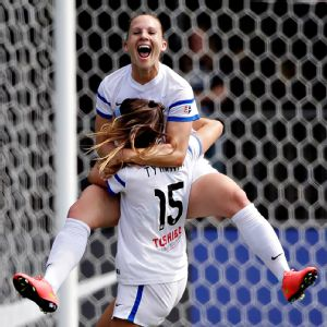 FC Kansas City's Amy Rodriguez celebrates one of her two goals in the championship match with teammate Erika Tymrak.
