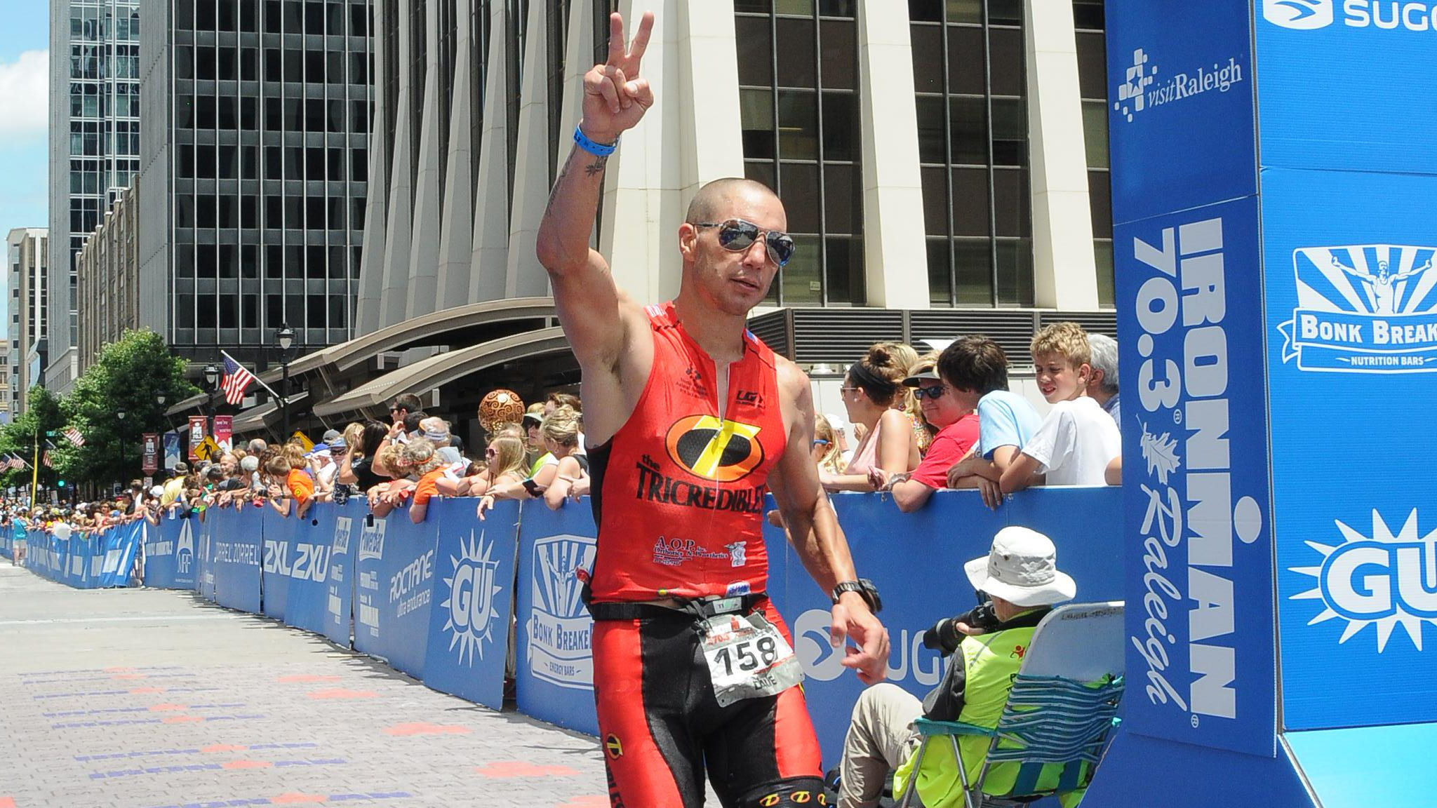 Dave Mirra, finishing his first IRONMAN 70.3 race last year in Raleigh, North Carolina.