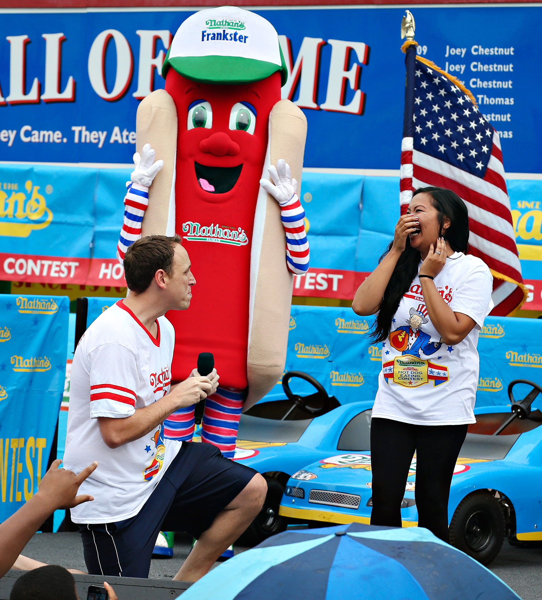 First Joey Chestnut successfully chowed down 61 hot dogs to win his eighth straight Nathan's Famous Fourth of July title this past summer, then he did what anyone would do -- he took a knee and proposed to his surprised girlfriend Neslie Ricasa.