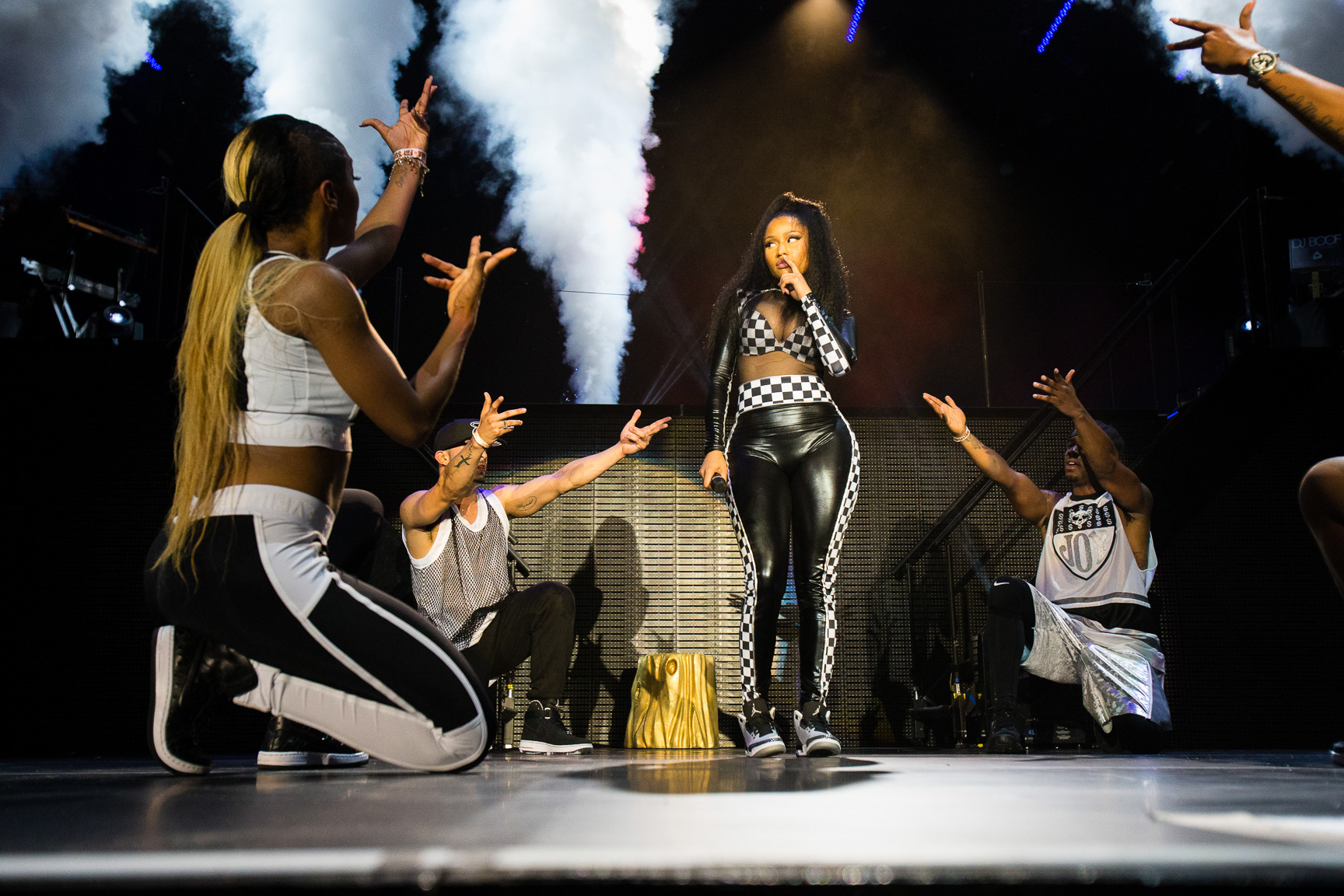 Friday's headlining musician Nicki Minaj put a cherry on top of the first full day of action at X Games Austin 2015.  Clad in a racetrack-inspired white-and-black checkered leather bodysuit, Minaj rocked the house and even brought her boyfriend Meek Mill up onstage for a surprise performance.