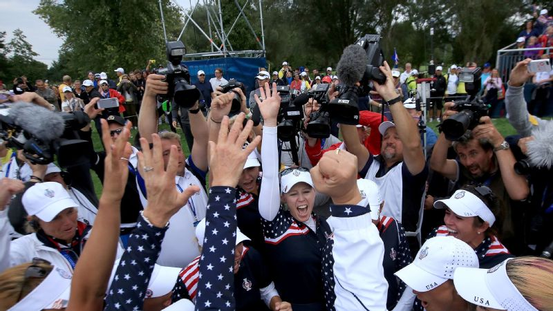 Morgan Pressel (center) and members of the U.S. team celebrate after winning 8.5 of a possible 12 points in the singles matches Sunday to capture the Solheim Cup.