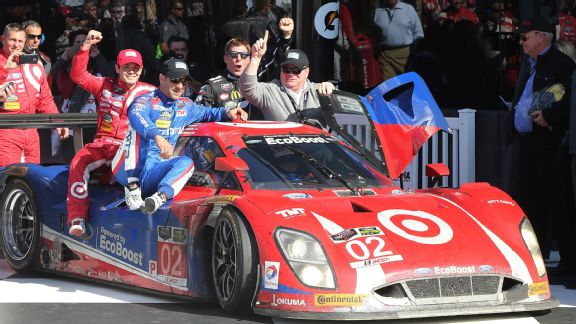 With Scott Dixon behind the wheel, fellow drivers Kyle Larson, Tony Kanaan and Jamie McMurray, from left, and team owner Chip Ganassi celebrate their overall Rolex 24 win on Jan. 25, 2015.