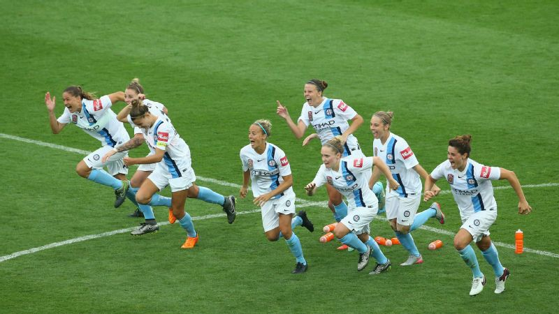 Melbourne City players celebrate after they defeated the Brisbane Roar in a penalty shoot out during the W-League semi final match between Melbourne City FC and Brisbane Roar at AAMI Park on January 25, 2016, in Melbourne, Australia.