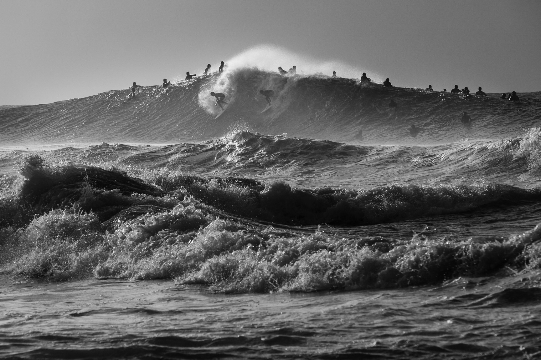 Surfers at Pipeline, Hawaii
