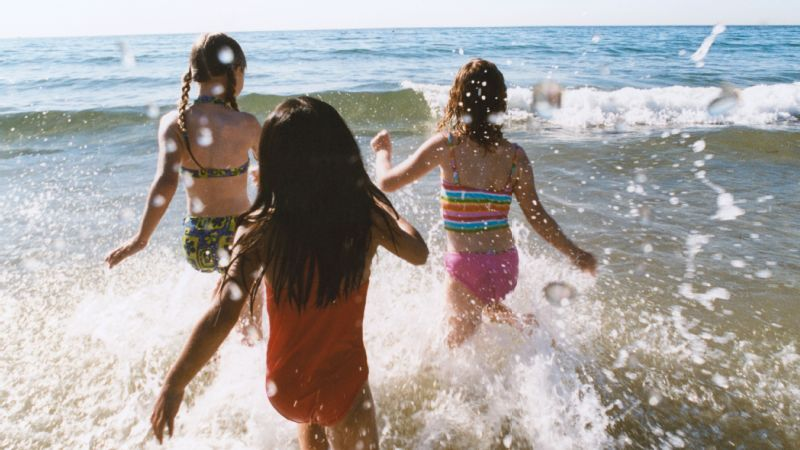 Three Girls Running in Sea