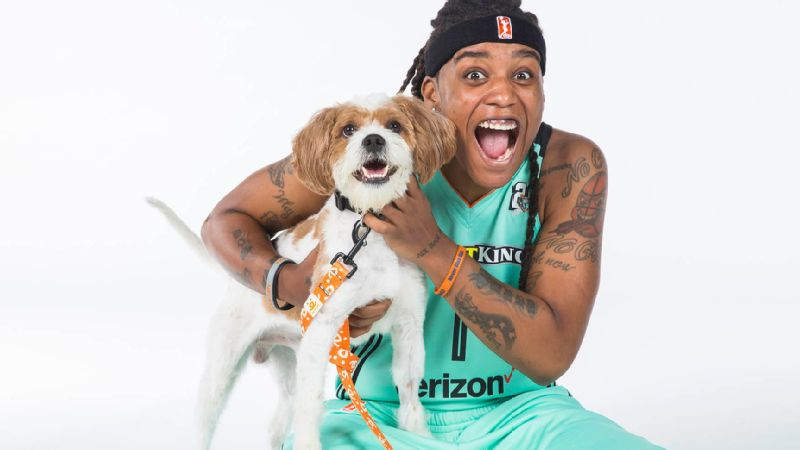Who's more happy ... New York Liberty player Shavonte Zellous, or the rescue dog she's posing with?