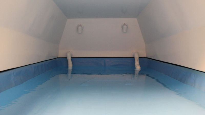 The inside view of a rectangular float tank.