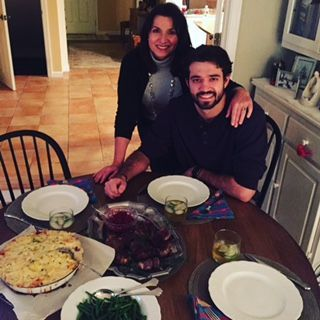 Edie and Adam on New Year's Eve, with a meal Adam prepared for his parents.