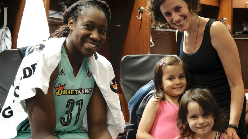 Forward Tina Charles with writer Ellen Hagan and her daughters Miriam, age 3 and Celi, age 5.