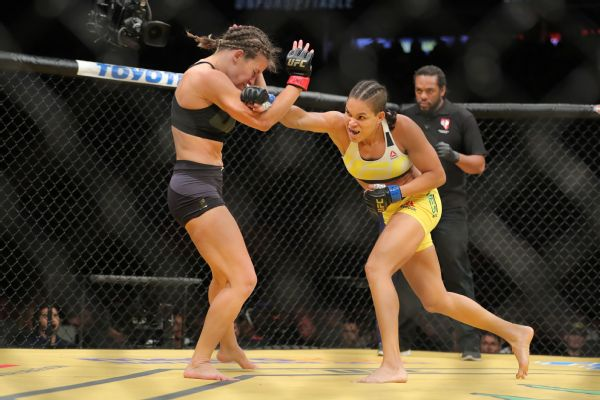 Amanda nunes right bloodied miesha tate with a series of stiff jabs