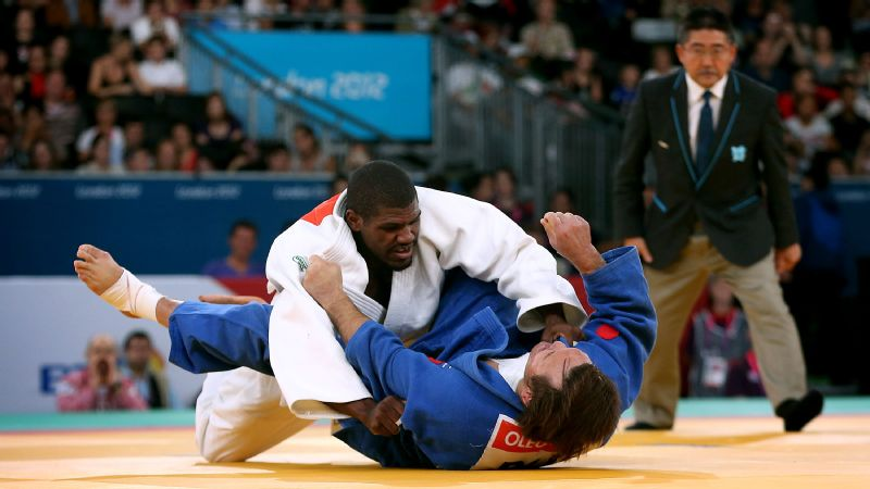 Russia's Oleg Kretsul (blue) and Dartanyon Crockett of the U.S. compete in the 2012 Paralympics in London, but there will be no Russian team in 2016 in Rio because of state-sponsored doping.