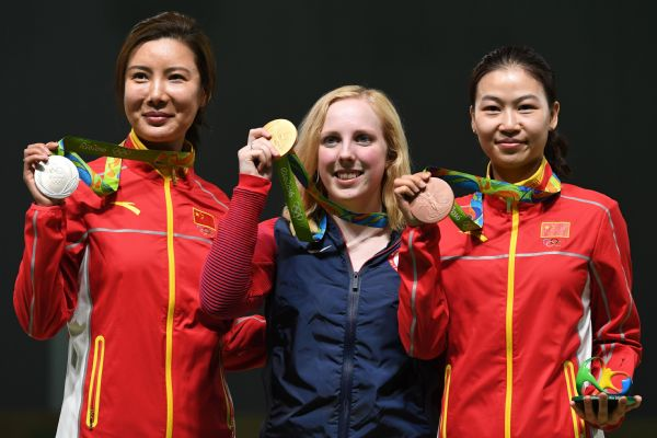 Ginny Thrasher, center, wins Team USA's first Olympic gold medal at the Rio Games in the women's 10-meter air rifle competition.