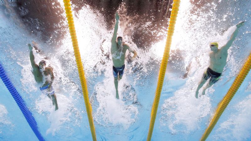 Conor Dwyer (center) competes against Gabriele Detti (left) and Mack Horton (right) in the final of the men's 400-meter freestyle on the first day of the Olympics.