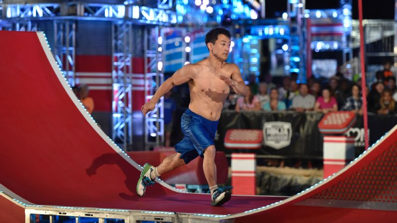 Tyler Yamauchi attempts the Warped Wall in American Ninja Warrior national finals.