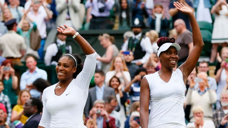 Serena and Venus Williams celebrate their women's doubles victory at Wimbledon in 2016. Serena also won singles.