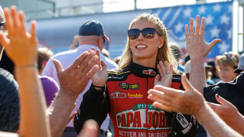 NHRA top fuel driver Leah Pritchett greets fans prior to the U.S. Nationals at Lucas Oil Raceway.