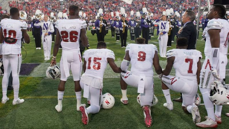 Nebraska linebacker Michael Rose-Ivey, defensive end DaiShon Neal and linebacker Mohamed Barry took a knee during the national anthem before the Huskers' 24-13 win against Northwestern on Saturday.