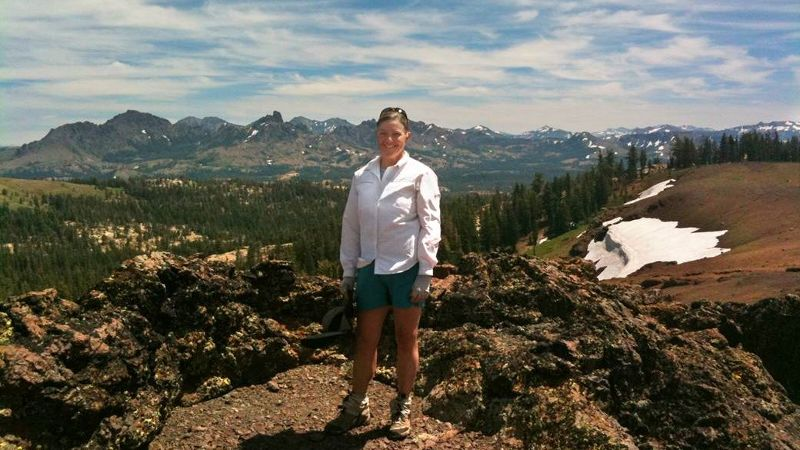 The Pacific Crest Trail stretches 2,560 miles from Mexico to Canada. Here, Liz Bergeron, the executive director of the PCT Association, stands atop Raymond Peak near the Blue Lakes in California.