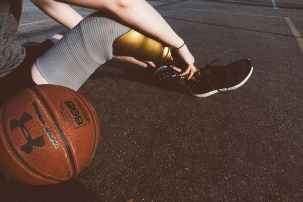 A girl, the blacktop and her ball.