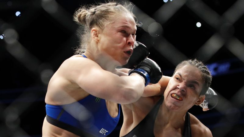 Amanda Nunes, right, forced a first-round TKO of Ronda Rousey while defending her UFC bantamweight title Friday night.