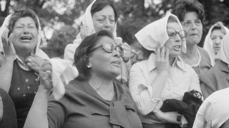 The Mothers of the Plaza de Mayo engage in an anti-government protest over the imprisonment and kidnappings of their husbands and children, many of them Argentinian journalists, in Buenos Aires in 1977.