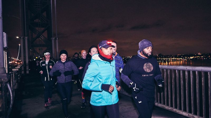Alison (center) and fellow runners traveling across the George Washington Bridge in Fort Lee, New Jersey.
