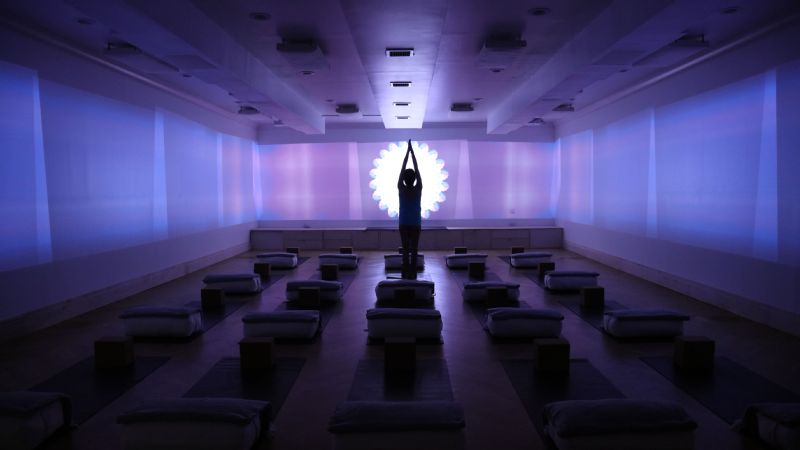 The high-energy part of the class includes a light show, music and a challenging yoga flow.
