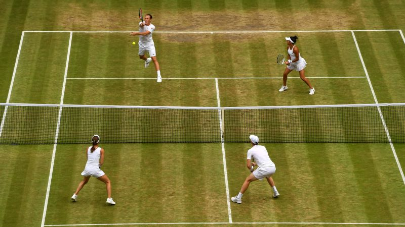 Jamie Murray of Great Britain and partner Martina Hingis of Switzerland (bottom) in action during the Mixed Doubles final match
