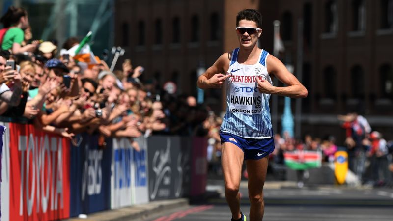 Callum Hawkins shows his pride in front of the home supporters as he runs to the line for a fourth-placed finish in the men's marathon at the World Championships.