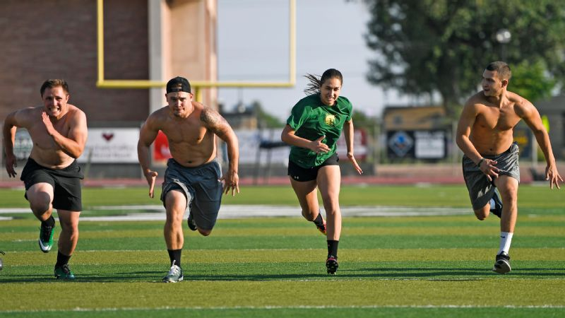 Quarterback Jorge Hernandez, right, knows Becca Longo is out to land more than just a roster spot at Adams State.