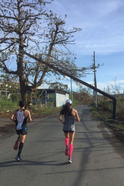 Beverly Ramos ran around downed power lines and trees during marathon training.